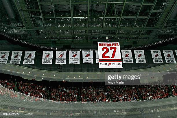 Scott Niedermayer's number 27 jersey is raised to the rafters during the jersey retirement ceremony prior to the game between the New Jersey Devils...