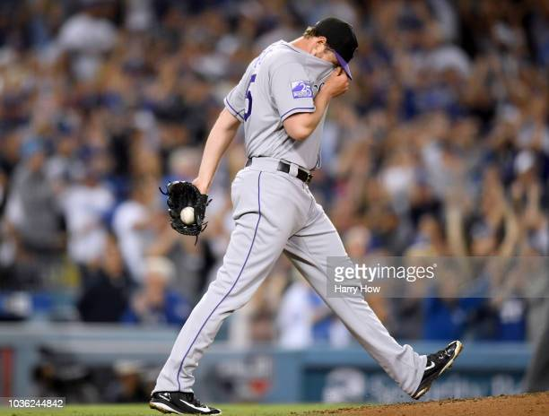Scott Oberg of the Colorado Rockies reacts after giving up a three run homerun to Yasiel Puig of the Los Angeles Dodgers for a 52 Dodger lead during...