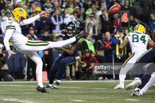 Scott of the Green Bay Packers punts the ball in the first half against the Seattle Seahawks at CenturyLink Field on November 15 2018 in Seattle...