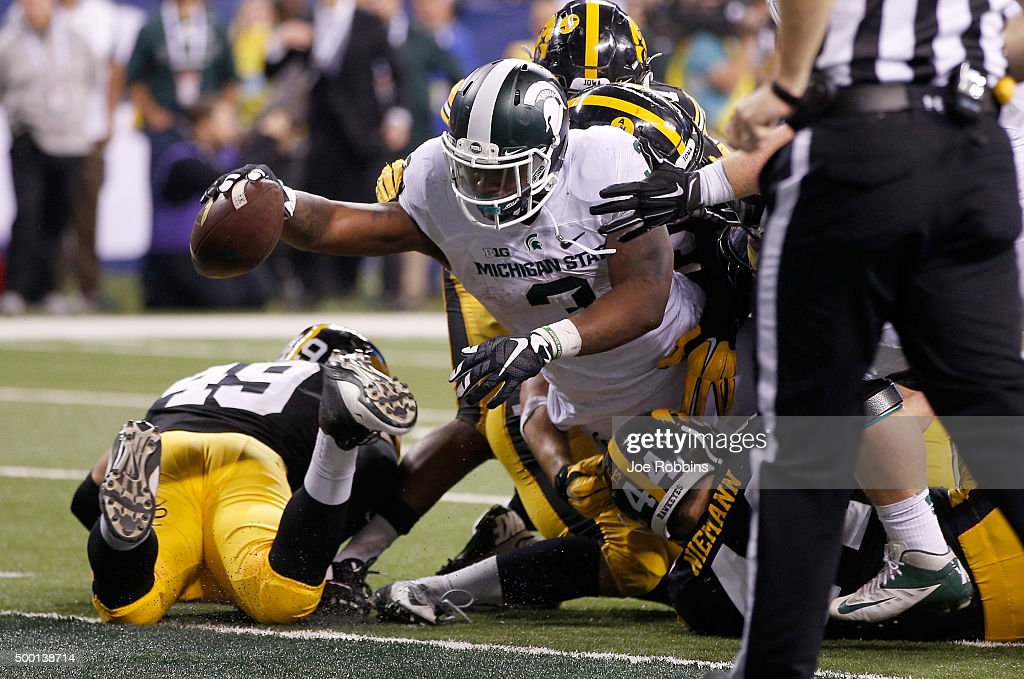 LJ Scott #3 of the Michigan State Spartans reaches into the end zone against the Iowa Hawkeyes in the Big Ten Championship at Lucas Oil Stadium on December 5, 2015 in Indianapolis, Indiana.