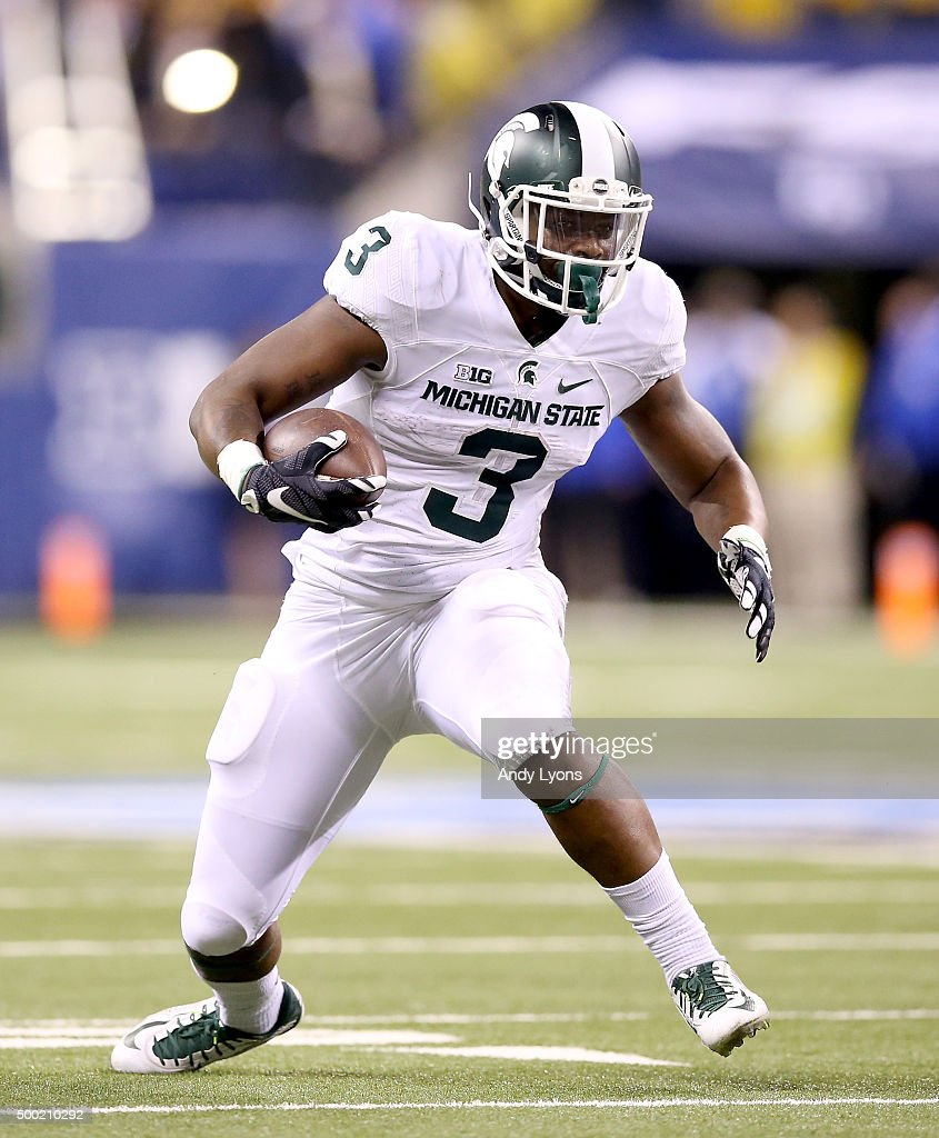 LJ Scott #3 of the Michigan State Spartans runs with the ball against the Iowa Hawkeyes in the Big Ten Championship at Lucas Oil Stadium on December 5, 2015 in Indianapolis, Indiana.