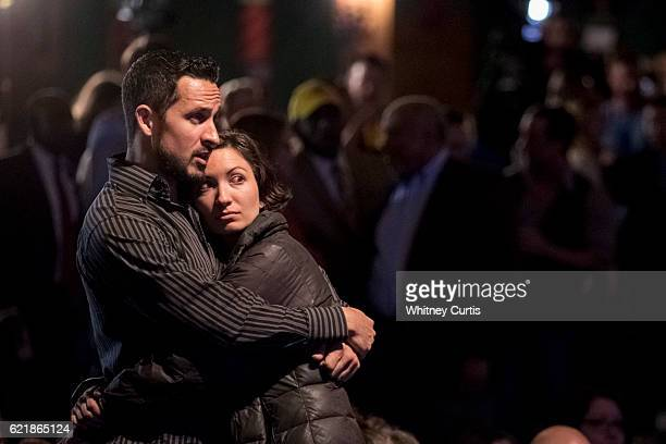Scott O'Leary and Bridget Clonts supporters of Jason Kander and Hillary Clinton embrace as they watch poll returns at Uptown Theater on November 8...