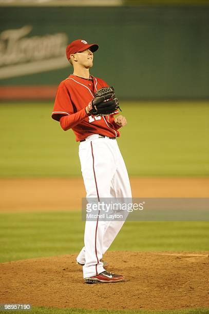 Scott Olsen of the Washington Nationals reacts to losing a no hitter after taking taking it to 8 1/3 innings during a baseball game against the...
