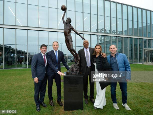 Scott O'Neil Bryan Colangelo Julius Irving and family during the unveiling of the Doctor J sculpture on April 3 2018 at the Legends Walk at the...