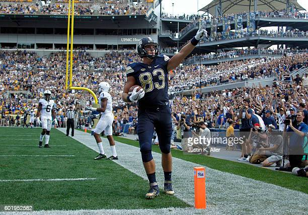 Scott Orndoff of the Pittsburgh Panthers celebrates after catching a 2 yard touchdown pass in the first half during the game against the Penn State...