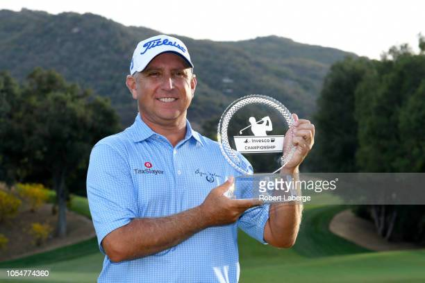 Scott Parel poses with the winner's trophy after winning the PGA Champions Tour 2018 Invesco QQQ Championship at the Sherwood Country Club on October...