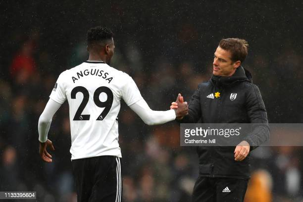 Scott Parker manager of Fulham and AndreFrank Zambo Anguissa of Fulham after the match during the Premier League match between Fulham FC and Chelsea...