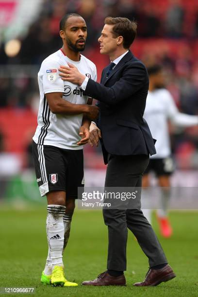 Scott Parker Manager of Fulham and Denis Odoi of Fulham embrace after the Sky Bet Championship match between Bristol City and Fulham FC at Ashton...