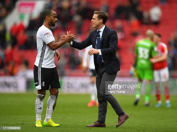 Scott Parker Manager of Fulham and Denis Odoi of Fulham shake hands after the Sky Bet Championship match between Bristol City and Fulham FC at Ashton...