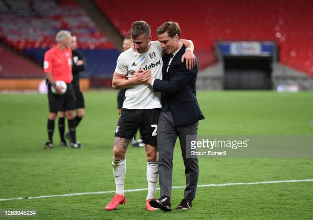 Scott Parker manager of Fulham celebrates with goalscorer Joe Bryan of Fulham after the Sky Bet Championship Play Off Final match between Brentford...