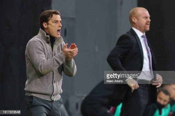 Scott Parker, Manager of Fulham gives his team instructions during the Premier League match between Fulham and Burnley at Craven Cottage on May 10,...