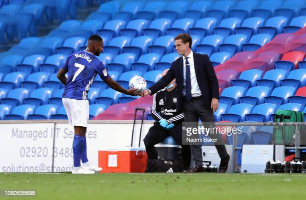 Scott Parker manager of Fulham hands the ball to Leandro Bacuna of Cardiff City during the Sky Bet Championship Play Off Semi-final 1st Leg match...