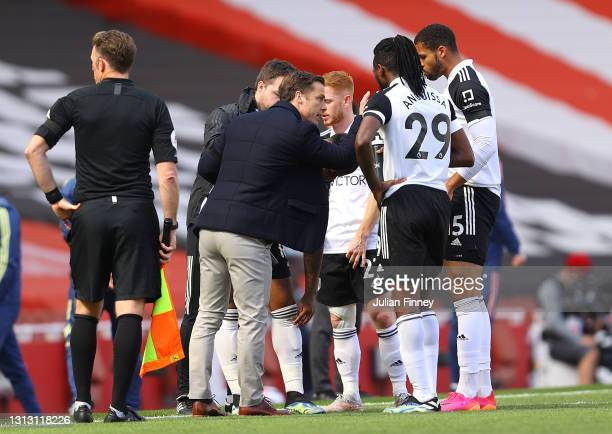 Scott Parker, Manager of Fulham speaks with Harrison Reed, Ruben Loftus-Cheek and Andre-Frank Zambo Anguissa of Fulham during the Premier League...