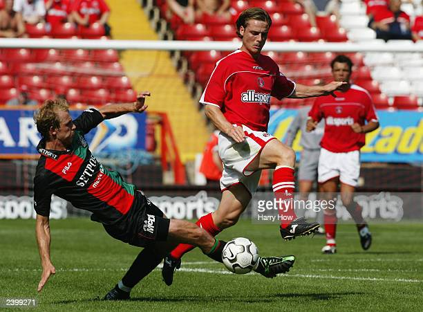 Scott Parker of Charlton Athletic leaps from the tackle of Arjan Ebbinge of NECNijmegen during the preseason friendly match between Charlton Athletic...