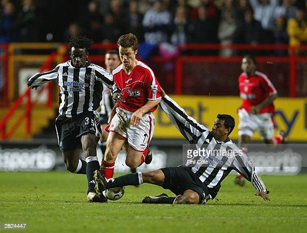 Scott Parker of Charlton gets tackled by Olivier Bernard and Nolberto Solano of Newcastle during the FA Barclaycard Premiership match between...