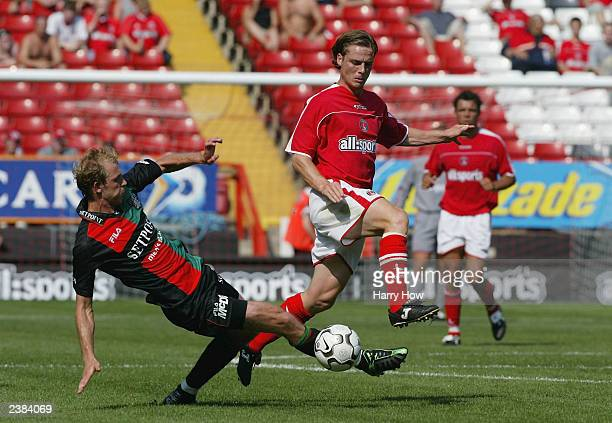 Scott Parker of Charlton jumps the tackle of Arjan Ebbinge of NECNijmegen during the preseason friendly match between Charlton Athletic and...