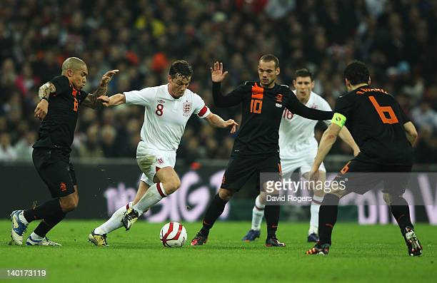 Scott Parker of England battles for the ball with Nigel De Jong Wesley Sneijder and Mark van Bommel of Netherlands during the international friendly...