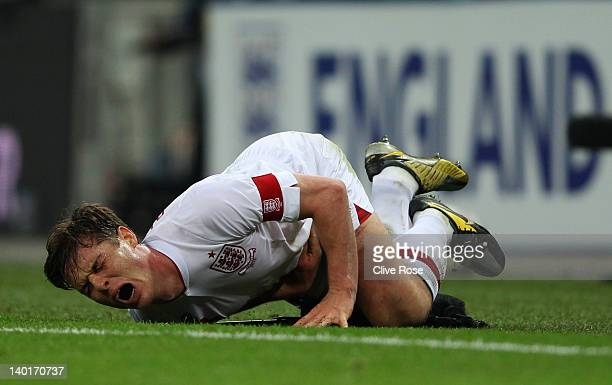 Scott Parker of England grimaces as he slides into a pitchside microphone during the international friendly match between England and Netherlands at...