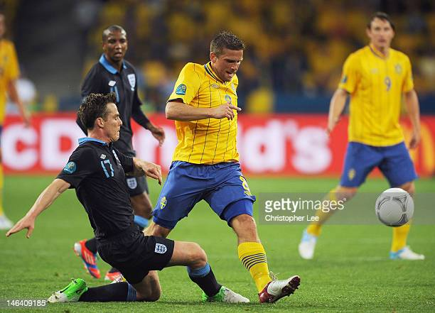 Scott Parker of England tackles Anders Svensson of Sweden during the UEFA EURO 2012 group D match between Sweden and England at The Olympic Stadium...