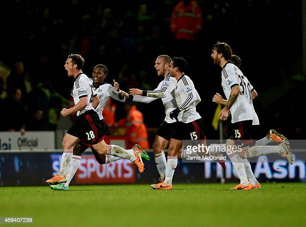 Scott Parker of Fulham celebrates with team mates as he scores their second goal during the Barclays Premier League match between Norwich City and...