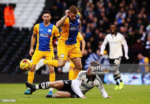 Scott Parker of Fulham challenges Eoin Doyle of Preston North End during the Sky Bet Championship match between Fulham and Preston North End at...