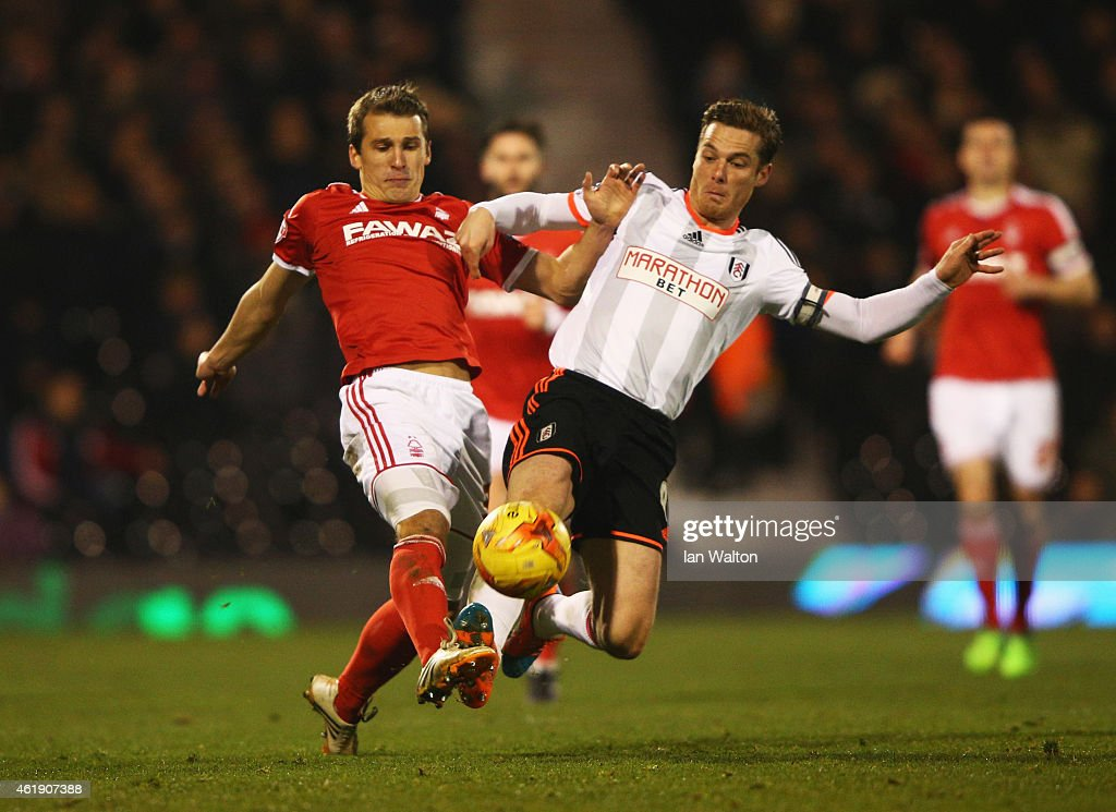 Scott Parker of Fulham challenges Robert Tesche of Nottingham Forest during the Sky Bet Championship match between Fulham and Nottingham Forest at Craven Cottage on January 21, 2015 in London, England.