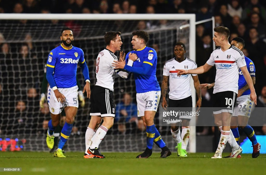 Scott Parker of Fulham clashes with Kalvin Phillips of Leeds United and is sent off during the Sky Bet Championship match between Fulham and Leeds United at Craven Cottage on March 7, 2017 in London, England.