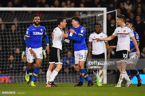 Scott Parker of Fulham clashes with Kalvin Phillips of Leeds United and is sent off during the Sky Bet Championship match between Fulham and Leeds...