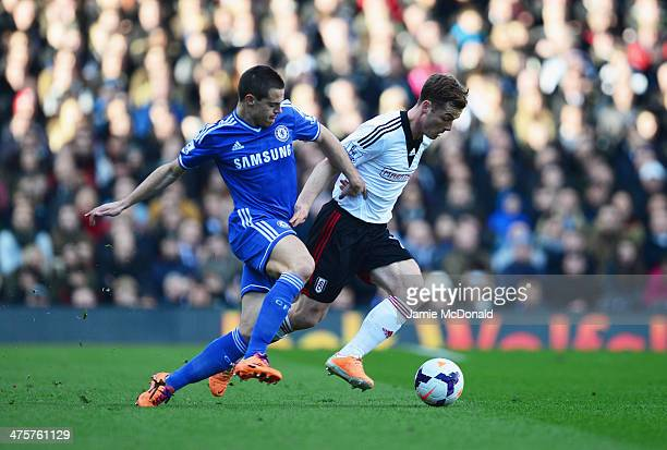 Scott Parker of Fulham holds off Cesar Azpilicueta of Chelsea during the Barclays Premier League match between Fulham and Chelsea at Craven Cottage...