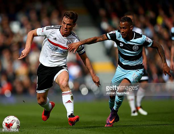Scott Parker of Fulham holds off pressure from Tjaronn Chery of QPR during the Sky Bet Championship match between Fulham and Queens Park Rangers at...