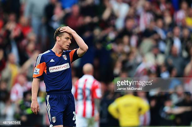 Scott Parker of Fulham reacts as his side concedes a second goal during the Barclays Premier League match between Stoke City and Fulham at the...