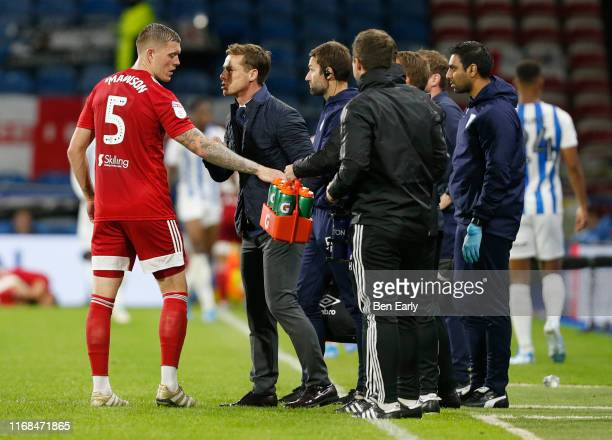 Scott Parker of Fulham talks to Alfie Mawson of Fulham during the Sky Bet Championship match between Huddersfield Town and Fulham at John Smith's...