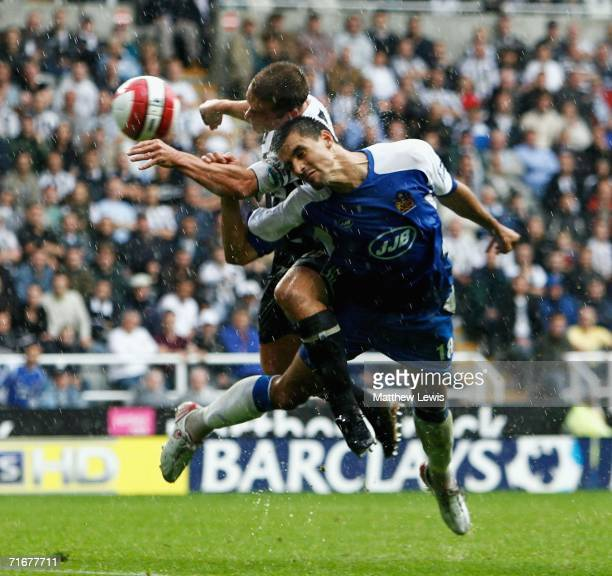 Scott Parker of Newcastle beats Paul Scharner of Wigan to score a goal during the Barclays Premiership match between Newcastle United and Wigan...