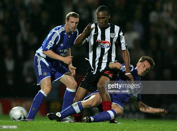 Scott Parker of Newcastle tackles Calvin Andrew of Grimsby during the Carling Cup Third round match between Grimsby Town and Newcastle United at...