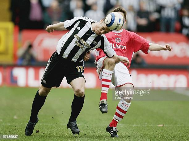 Scott Parker of Newcastle United battles for the ball with Matt Holland of Charlton Athletic during the Barclays Premiership match between Charlton...
