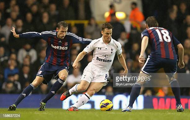 Scott Parker of Tottenham Hotspur is closed down by Peter Crouch and Dean Whitehead of Stoke City during the Barclays Premier League match between...