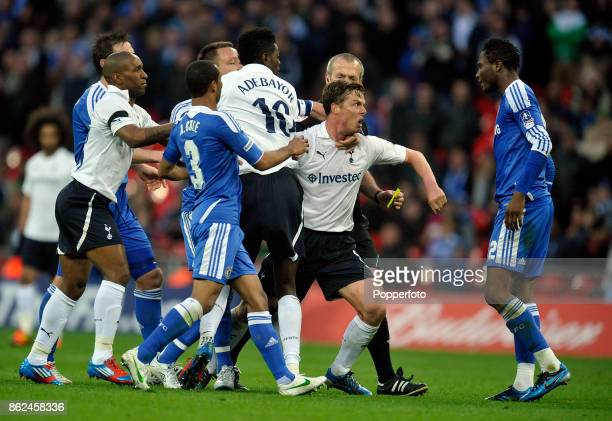 Scott Parker of Tottenham Hotspur loses his temper with John Obi Mikel of Chelsea during the FA Cup Semi Final match at Wembley Stadium on April 15...