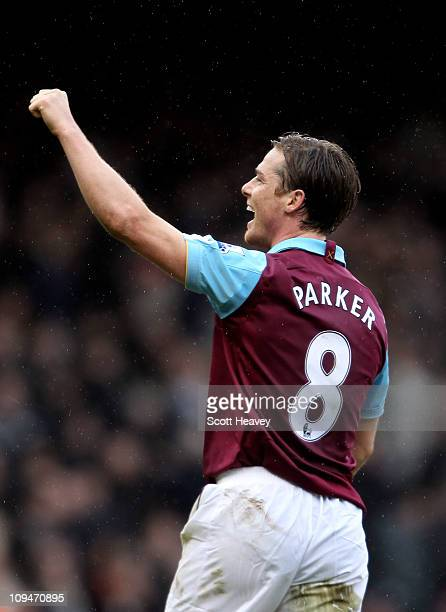 Scott Parker of West Ham celebrates as teammate Carlton Cole scores their third goal during the Barclays Premier League match between West Ham United...