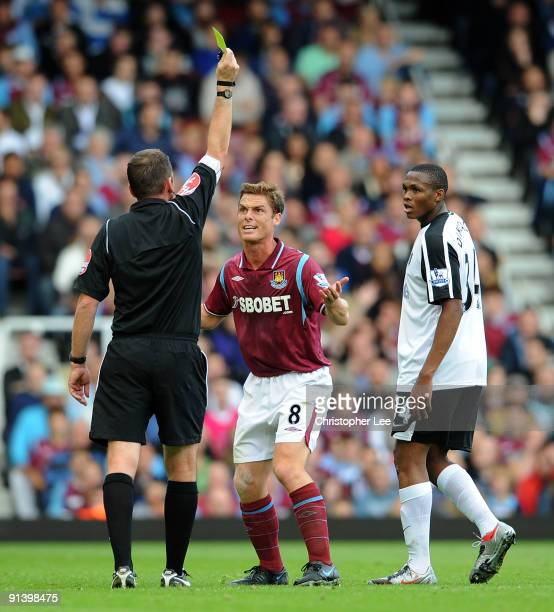 Scott Parker of West Ham looks disappointed as he is booked by referee Phil Dowd during the Barclays Premier League match between West Ham United and...