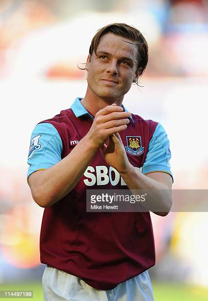 Scott Parker of West Ham salutes the fans at the end of the Barclays Premier League match between West Ham United and Sunderland at Boleyn Ground on...