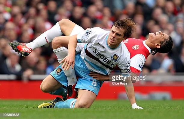 Scott Parker of West Ham tackles Neves Denilson of Arsenal during the Barclays Premier League match between Arsenal and West Ham United at Emirates...