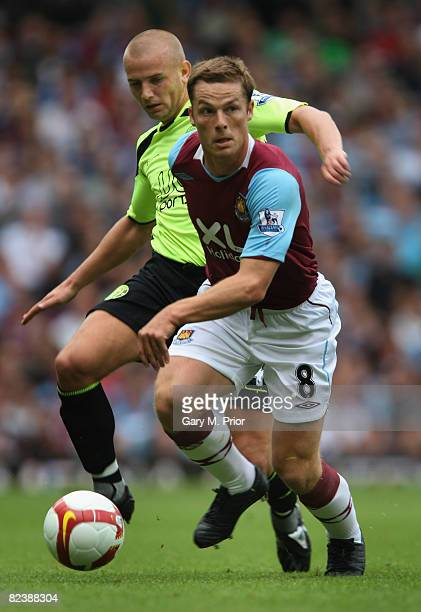 Scott Parker of West Ham United and Lee Cattermole of Wigan Athletic in action during the Barclays Premier League match between West Ham United and...