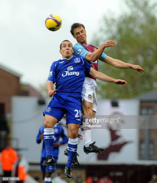 Scott Parker of West Ham United and Leon Osman of Everton battle for the ball during the Barclays Premier League match between West Ham United and...