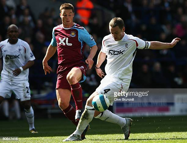 Scott Parker of West Ham United challenges Kevin Nolan of Bolton Wanderers during the Barclays Premier League match between Bolton Wanderers and West...