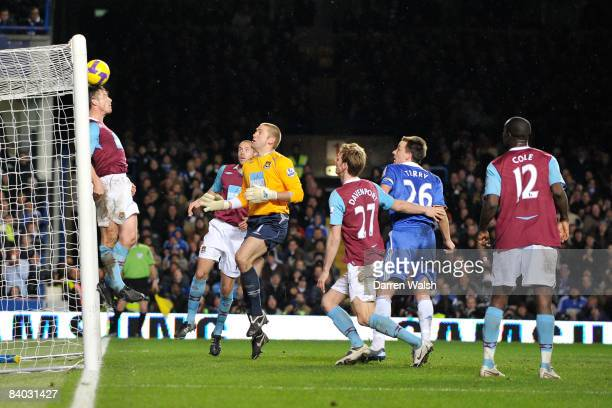 Scott Parker of West Ham United clears off the line during the Barclays Premier League match between Chelsea and West Ham United at Stamford Bridge...