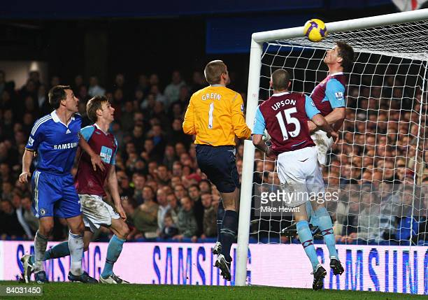 Scott Parker of West Ham United heads the ball off the line during the Barclays Premier League match between Chelsea and West Ham United at Stamford...
