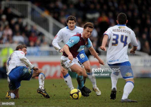 Scott Parker of West Ham United is surrounded by Hartlepool players during the FA Cup Sponsored by Eon 4th Round match between Hartlepool United and...