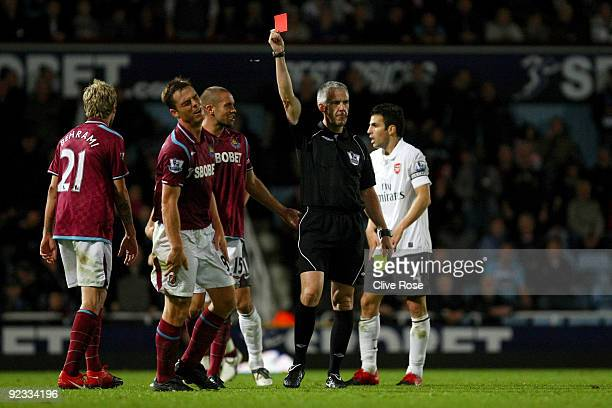 Scott Parker of West Ham United receives a red card from referee Chris Foy during the Barclays Premier League match between West Ham United and...