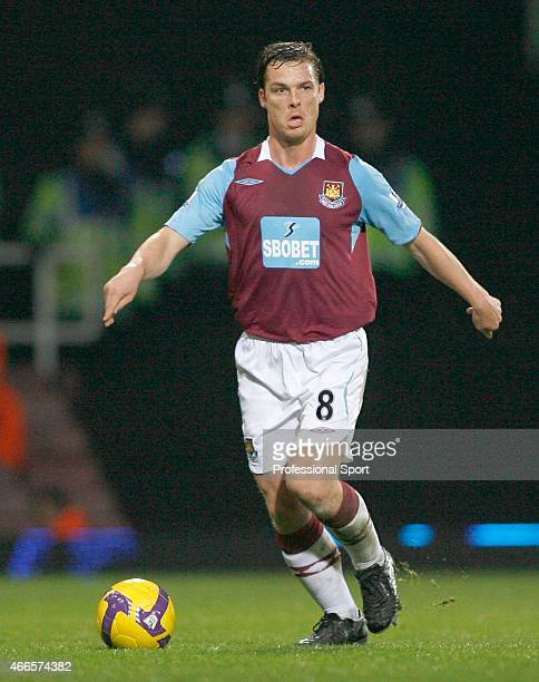 Scott Parker of West Ham United runs with the ball during the Barclays Premier League match between West Ham United and Tottenham Hotspur at Upton...
