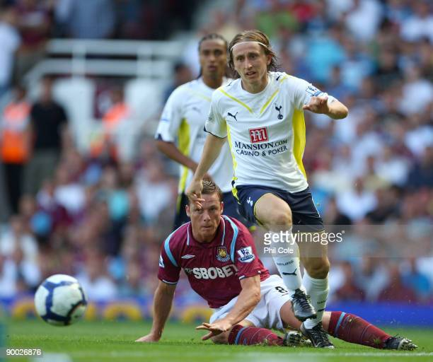 Scott Parker of West Ham United tackles Luka Modric of Tottenham Hotspur during the Barclays Premier League match between West Ham United and...